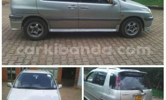 Buy Used Toyota Raum Silver Car in Kampala in Uganda
