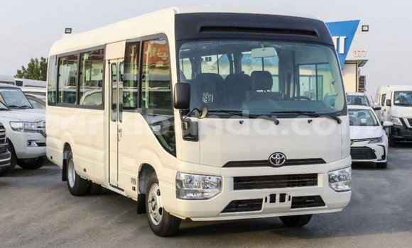 Medium with watermark toyota coaster uganda import dubai 9226