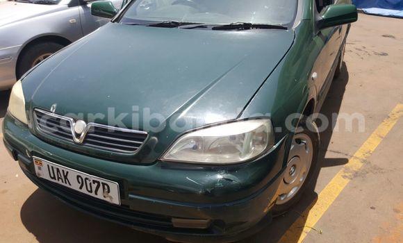 Gura Yakoze Opel Astra Green Imodoka i Kampala mu Uganda